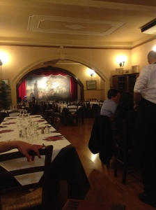The dining area in the restaurant. Notice the mural in the back.